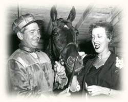 Maywood Park's leading driver of the 1950s Harry Burright gives some handicapping pointers to stage, screen and singing star Jeanette MacDonald.