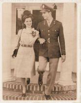 couple-stepping-off-porch